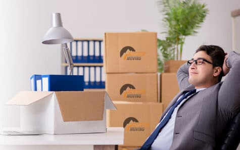 It shows an office worker who is thinking on how to choose the best commercial moving company in Calgary